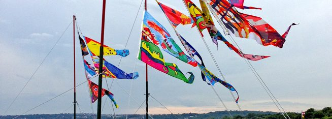 Public Art Installation from Locws Schools Project Featuring Flags Designed by School Children Across Swansea