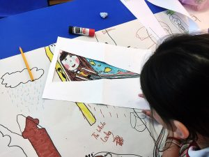 Locws Schools Year of Legends Flag Project: Design from Whitestone Primary School Picturing a Girl