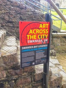 Locws International Art Across the City Information Sign located at Oystermouth Castle in Mumbles